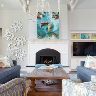 Inspiration for a mid-sized beach style open concept dark wood floor living room remodel in Other with gray walls, a standard fireplace and a media wall
