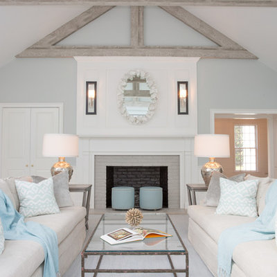 Beach style formal living room photo in Boston with gray walls, a standard fireplace and a brick fireplace