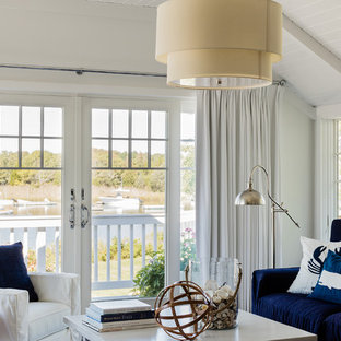 Example of a large beach style formal and open concept living room design in Boston with white walls