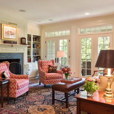 Living room - mid-sized traditional formal and open concept dark wood floor and brown floor living room idea in Other with beige walls, a standard fireplace and a stone fireplace