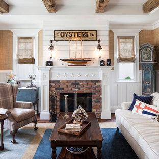 Inspiration för maritima separata vardagsrum, med en standard öppen spis och en spiselkrans i tegelsten