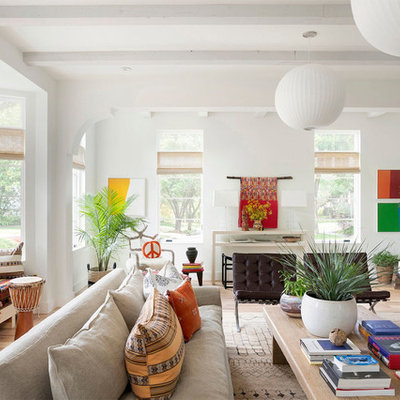 Living room library - eclectic light wood floor and beige floor living room library idea in Minneapolis with white walls