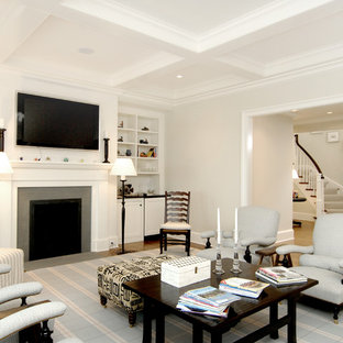 Coastal formal and open concept light wood floor living room photo in Boston with white walls, a standard fireplace, a media wall and a concrete fireplace