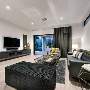 Inspiration for a contemporary formal living room in Perth with white walls, a wall-mounted tv and beige floor.