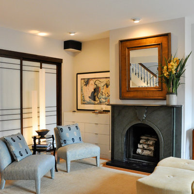 Living room - asian medium tone wood floor living room idea in DC Metro with a standard fireplace