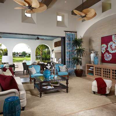 Island style open concept living room photo in Miami with white walls