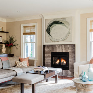 Inspiration for a large traditional formal living room in Boston with beige walls, a standard fireplace, medium hardwood floors and a stone fireplace surround.