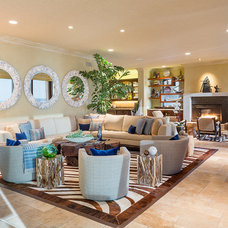Tropical Living Room by dRichards Interiors