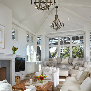 Living room - mid-sized beach style open concept medium tone wood floor living room idea in San Francisco with white walls, a standard fireplace, a stone fireplace and a media wall