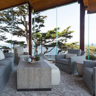 サンフランシスコの巨大なビーチスタイルのおしゃれなLDK (フォーマル、ベージュの壁、無垢フローリング、テレビなし) の写真