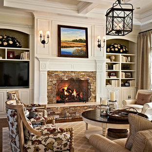Elegant formal living room photo in Charlotte with beige walls, a standard fireplace, a stone fireplace and a tv stand