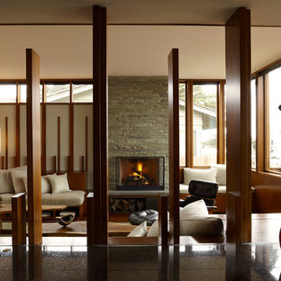 Example of a minimalist living room design in Chicago with a standard fireplace and no tv