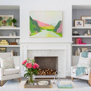 ダラスの広いビーチスタイルのおしゃれなLDK (白い壁、濃色無垢フローリング、標準型暖炉、石材の暖炉まわり、茶色い床) の写真