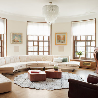 Mid-sized transitional formal and open concept medium tone wood floor living room photo in New York with beige walls, a standard fireplace, no tv and a wood fireplace surround
