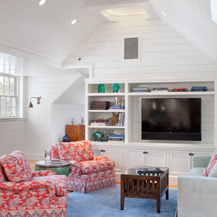 Mid-sized coastal open concept medium tone wood floor living room photo in Providence with white walls and a media wall