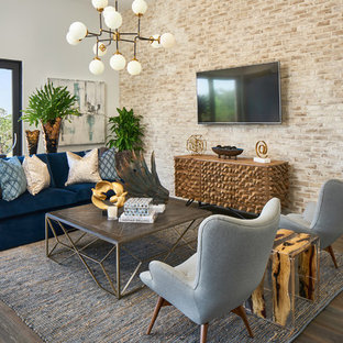 Example of a mid-sized transitional dark wood floor and brown floor living room design in Austin with beige walls and a wall-mounted tv