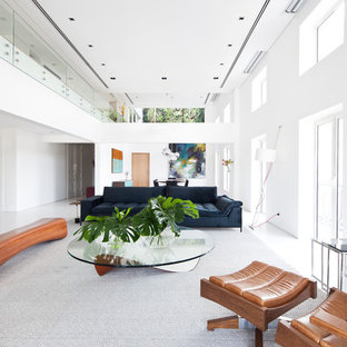 Inspiration for a contemporary open concept white floor living room remodel in Other with white walls