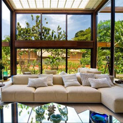 tropical living room by Tania Summit Interior Design