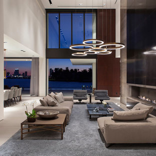 Living room - contemporary open concept gray floor living room idea in Miami with white walls and a ribbon fireplace