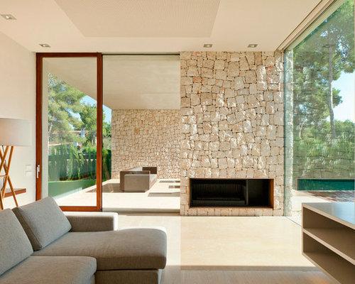 Soggiorno moderno con pavimento in travertino foto e for Soggiorno minimalista