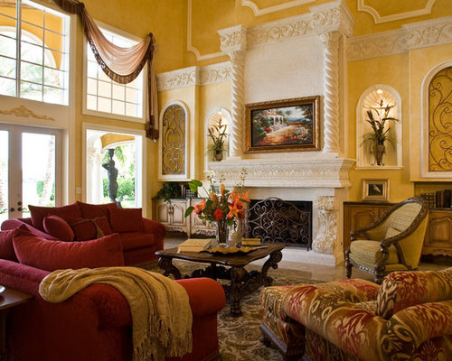 Example Of A Classic Living Room Design In Miami With Stone Fireplace Surround