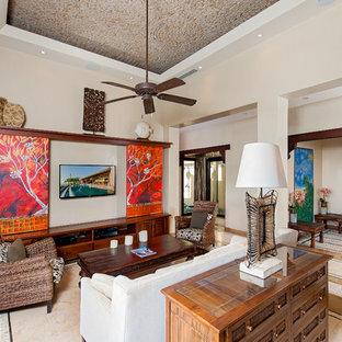 Idéer för medelhavsstil vardagsrum, med en dold TV och flerfärgat golv