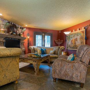 Ispirazione per un soggiorno chic di medie dimensioni e aperto con camino classico, sala formale, pareti rosse, pavimento in ardesia, cornice del camino in mattoni, nessuna TV e pavimento grigio