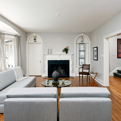Inspiration for a timeless brown floor living room remodel in DC Metro with a standard fireplace, no tv and gray walls