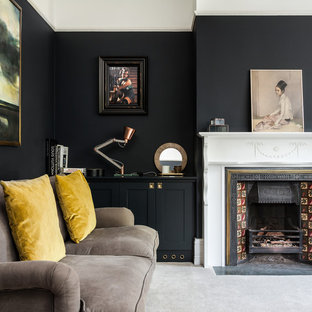 Design ideas for a classic living room in Surrey with black walls, a standard fireplace, carpet, a tiled fireplace surround and grey floors.