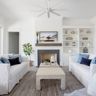 Inspiration for a coastal living room remodel in Charleston with white walls and a standard fireplace