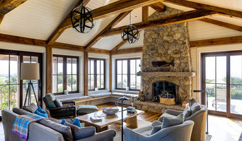 Casual beach living room with exposed wood barn beams