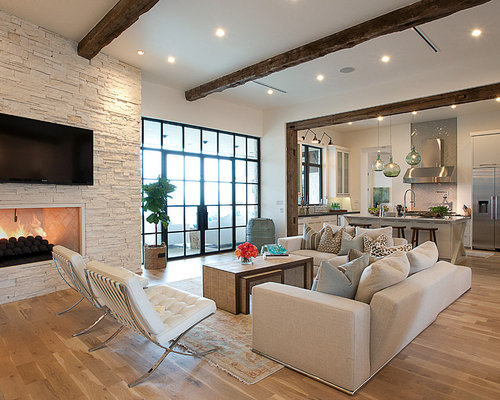 Transitional Open Concept Beige Floor Living Room Idea In Austin With A  Wall Mounted Tv