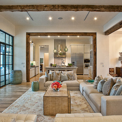 Transitional open concept living room photo in Austin with white walls