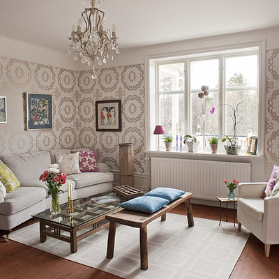 Inspiration for a mid-sized eclectic formal and enclosed medium tone wood floor living room remodel in Stockholm with beige walls, no fireplace and no tv