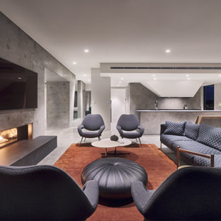 Design ideas for a large modern open concept living room in Perth with grey walls, concrete floors, a concrete fireplace surround, a wall-mounted tv, grey floor and a ribbon fireplace.
