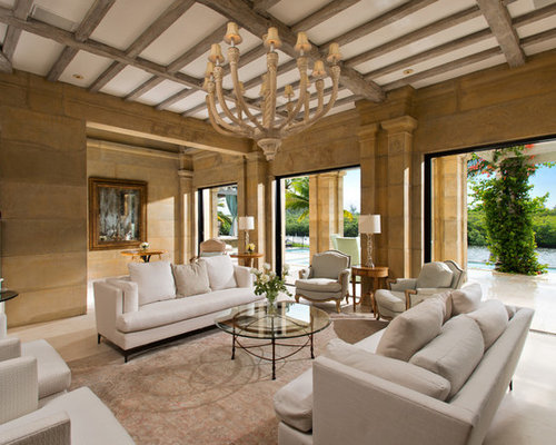 Example Of A Tuscan Living Room Design In Miami With Brown Walls And Beige  Floors