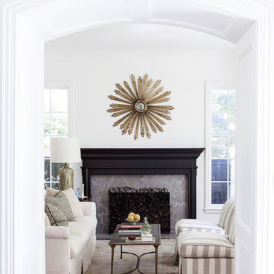 Example of a transitional formal living room design in Dallas with white walls and a standard fireplace