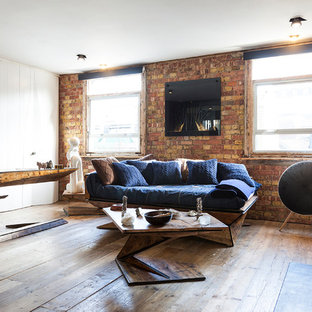 Living room - small industrial medium tone wood floor and brown floor living room idea in London with brown walls