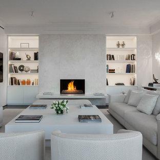 ニューヨークの大きいコンテンポラリースタイルのおしゃれなLDK (白い壁、濃色無垢フローリング、標準型暖炉、石材の暖炉まわり、埋込式メディアウォール、フォーマル) の写真