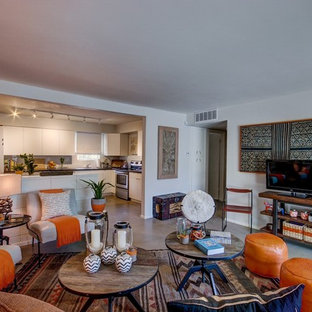 Living room - mid-sized eclectic open concept living room idea in Phoenix with no fireplace and a tv stand