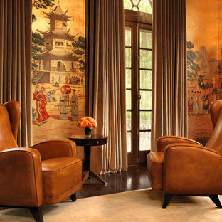 Inspiration for a world-inspired living room in St Louis with multi-coloured walls and dark hardwood flooring.