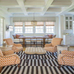 Inspiration for a timeless open concept medium tone wood floor and brown floor living room remodel in Albuquerque with white walls