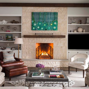 Inspiration for a transitional formal dark wood floor living room remodel in Dallas with gray walls, a standard fireplace, a stone fireplace and a wall-mounted tv