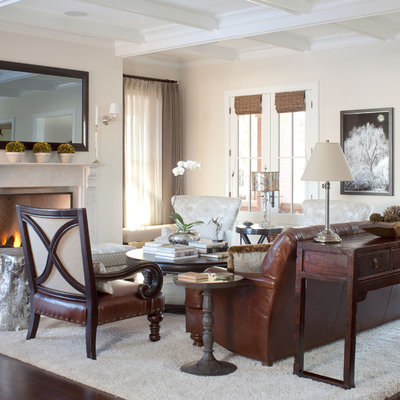 Inspiration for a timeless living room remodel in Denver with beige walls and a standard fireplace