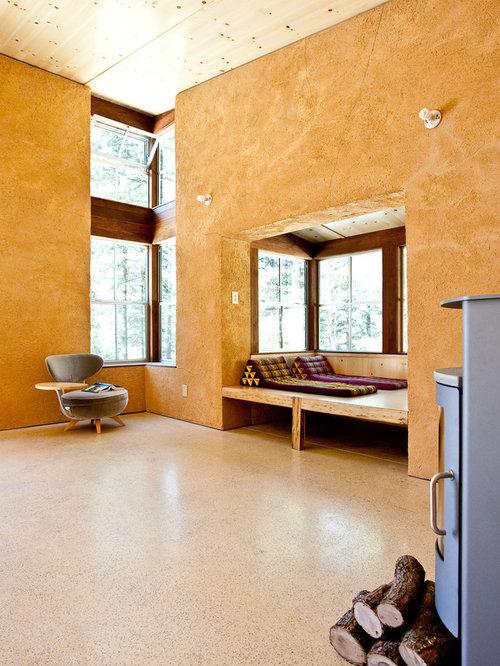 Soggiorno con stufa a legna e pareti arancioni - Foto e Idee per ...