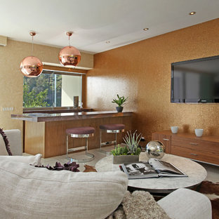 Midcentury modern living room photo in Los Angeles with no fireplace and a wall-mounted tv