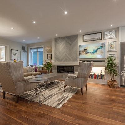Mid-sized transitional formal and open concept dark wood floor and brown floor living room photo in Toronto with gray walls, a standard fireplace, a tile fireplace and no tv