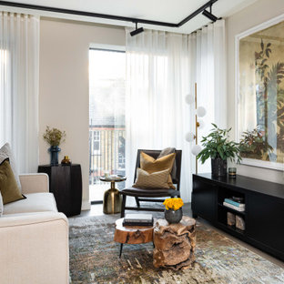 This is an example of a large contemporary formal open plan living room in London with beige walls and grey floors.