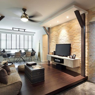 Example of a small trendy formal and enclosed dark wood floor and brown floor living room design in Singapore with multicolored walls and a tv stand