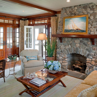 Living room - mid-sized formal and enclosed dark wood floor living room idea in Providence with beige walls, a standard fireplace, a stone fireplace and no tv